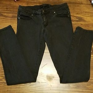 Black skinny pants with skull accents size 5